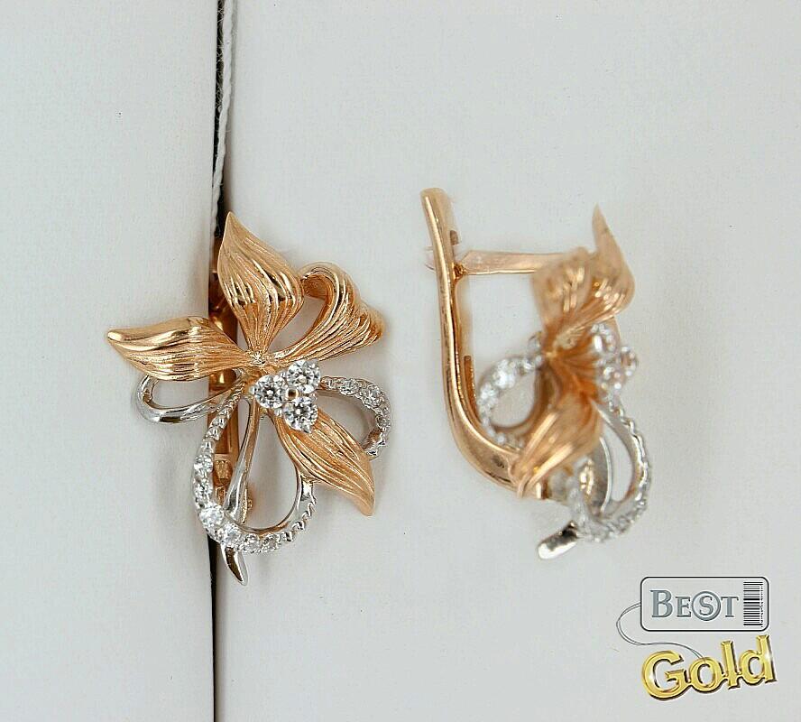 кольца и серьги из золота с камнями