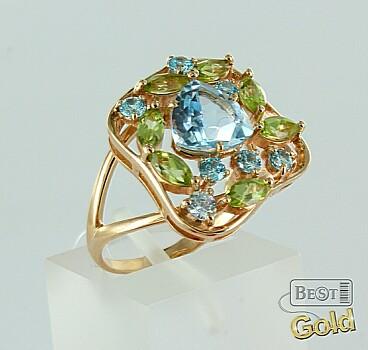 Золотое кольцо с топазами и хризолитами