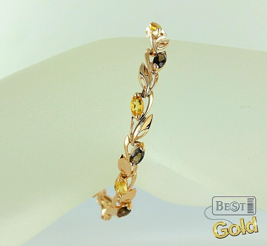 Золотой браслет с раухтопазами и цитринами