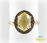 Золотое кольцо с цитрином и раухтопазами