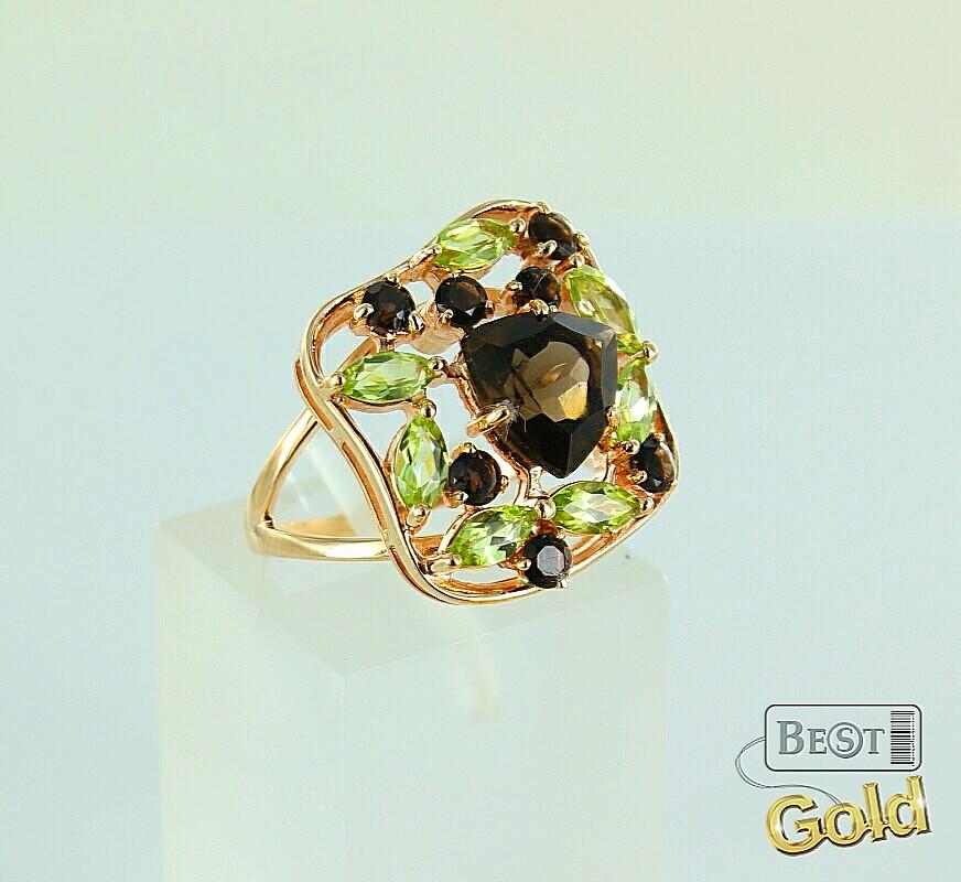 Золотое кольцо с раухтопазами и хризолитами