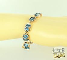 золотой браслет с топазом